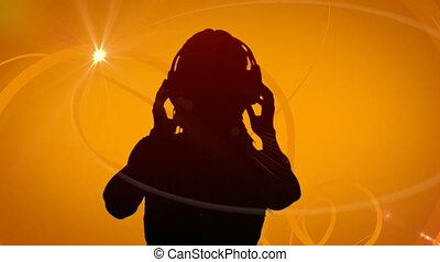 Animation of silhouette of a woman dancing listening to music with headphones on orange background