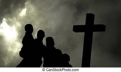 Animation of silhouette of Christian cross and a family over...