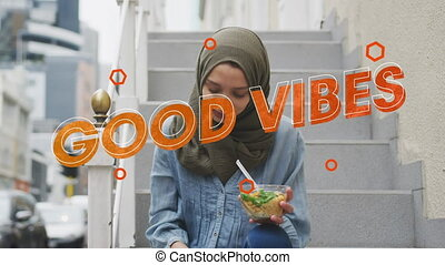 Animation of text vibes over woman eating salad