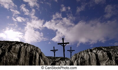 Animation of three Christian crosses over sunshine and ...