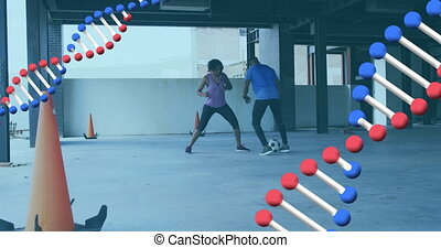 Animation of two dna strains spinning over man and woman playing football