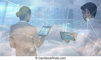 Animation of two people using digital tablets over a web of ...