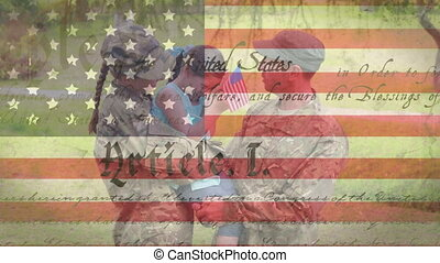 Animation of U.S. constitution floating with U.S. flag over Caucasian couple wearing military uniforms. United States of America presidential election democracy holiday concept digital composition