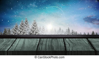 Animation of winter scenery with snow falling with wooden surface in the foreground. christmas festivity celebration concept digitally generated image.