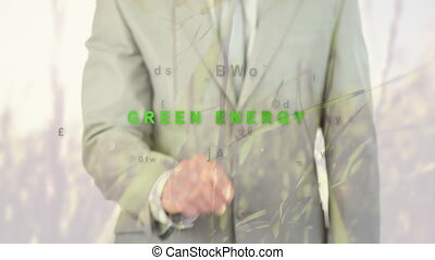 Animation of words Green Energy over a businessman - ...