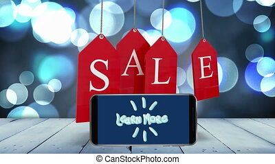 Animation of words Sale with words Learn More on screen of ...