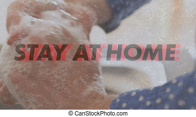 Animation of words Stay At Home Be Safe flashing over a ...
