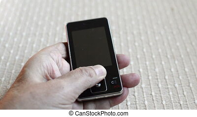 opening of nostalgic old cell phone ,close up footage -...
