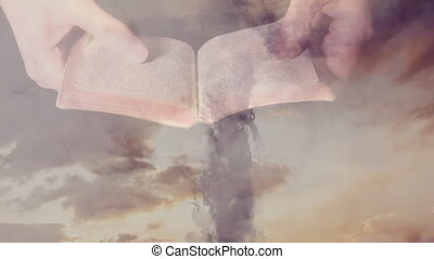 Animaton of Christian cross over a person holding the Bible...