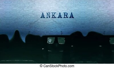 ANKARA Word closeup Being Typing and Centered on a Sheet of paper on old vintage Typewriter mechanical 4k Footage Background Animation.