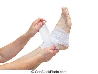 Nurse bandaging a broken ankle isolated
