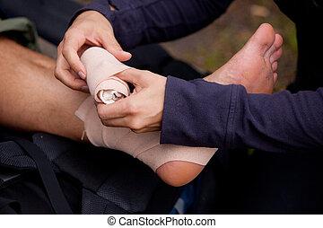 Ankle Tensor Bandage - A leg tensor bandage being applied...