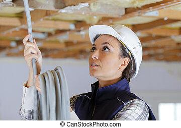 anläggningsarbetare, plats, kvinnlig