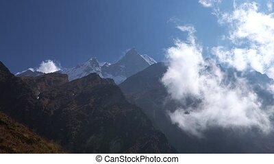 Annapurna region mountain timelapse. Timelapse of clouds around a mountain. Nepal.