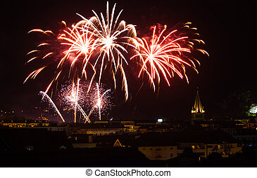 Bright fireworks light up the night sky for Bastille day, a major holiday in Annecy, France