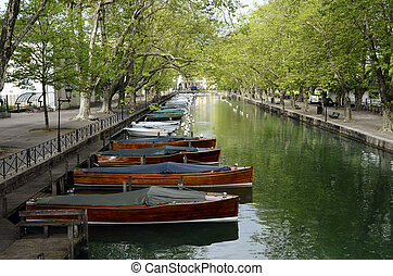 Annecy city, Thiou canal and wooden boats, Savoy, France