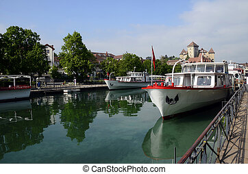 Annecy city, Thiou canal, boats and castle, Savoy, France