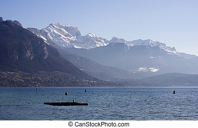 ANNECY, FRANCE : December 25, 2011 : Annecy lake and mountains on winter morning in France.