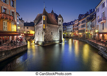 The old prison in Annecy, the Palais de l'isle, at dusk.