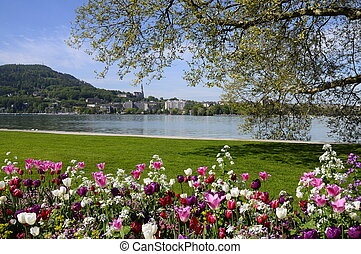 Annecy lake and city with flowerbed