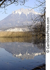 Annecy lake and Dents de la Forclaz mountain reflection in water