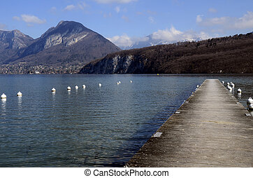 Annecy lake and mountains - Annecy lake, wooden pontoon and...