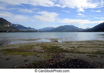 Annecy lake and mountains from Albigny beach, low tide,...