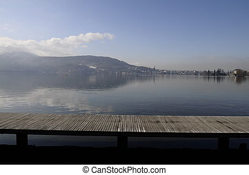 Annecy lake and view of city from walking wood pontoon