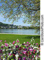 Annecy lake, flowers and city, Savoy, France