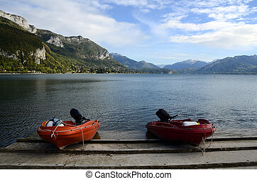 Annecy lake landscape and motor boats