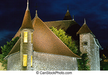 Annecy medieval town : Roofs of Old prison by night, France...