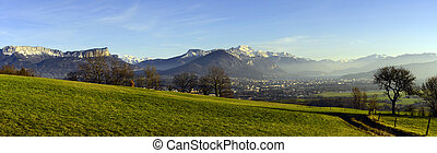 Annecy panorama, lake, city and snowed moutains. Overview...
