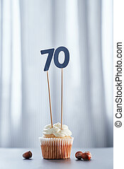 Anniversary cupcake with number 70 seventy