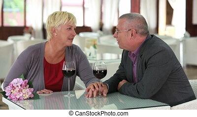Senior couple celebrating their wedding anniversary in restaurant