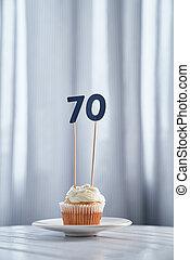 Anniversary vanilla cupcake with number 70 seventy
