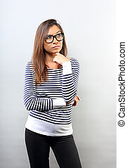 Annoyed angry latina young woman in eyeglasses thinking and looking up on blue background