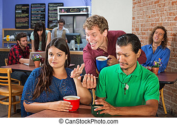 Annoyed Couple and Man with Phone