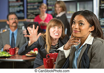 Annoyed Coworker - Annoyed coworker behind smiling business...