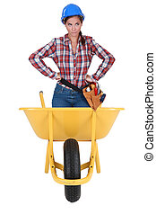 Annoyed girl in a barrow isolated on white background
