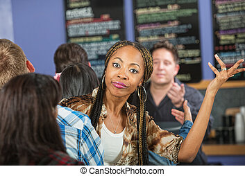 Annoyed Lady in Cafe - Annoyed young woman waiting in line...