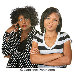 Annoyed Mother and Daughter - Black mother with teenage...