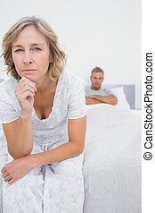 Annoyed woman looking at camera after fight with husband