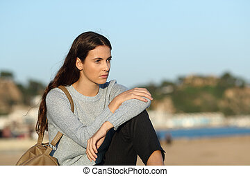 Annoyed woman looking away on the beach