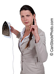 Annoyed woman with an iron