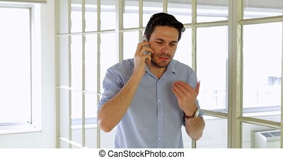Annoyed young man making a phone call