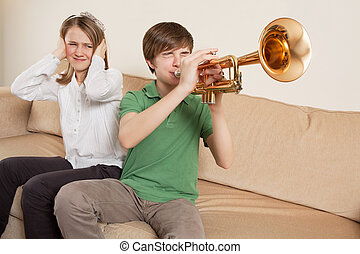 Annoying trumpet player - Photo of a brother playing his...