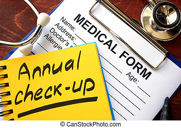 Annual check-up in a note and medical form.