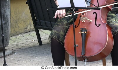 Annual Vilnius street music day. Musician hands playing classical music with double-bass in Vilnius