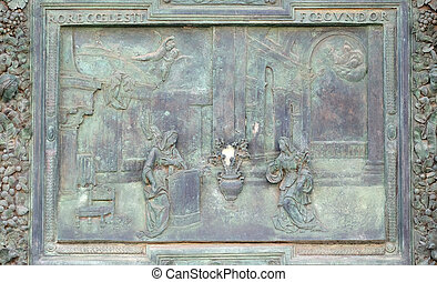 Annunciation of the Virgin Mary, detail of the central door of the Cathedral St. Mary of the Assumption in Pisa, Italy