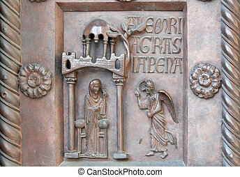 Annunciation of the Virgin Mary on the San Ranieri gate of the Cathedral St. Mary of the Assumption in Pisa, Italy